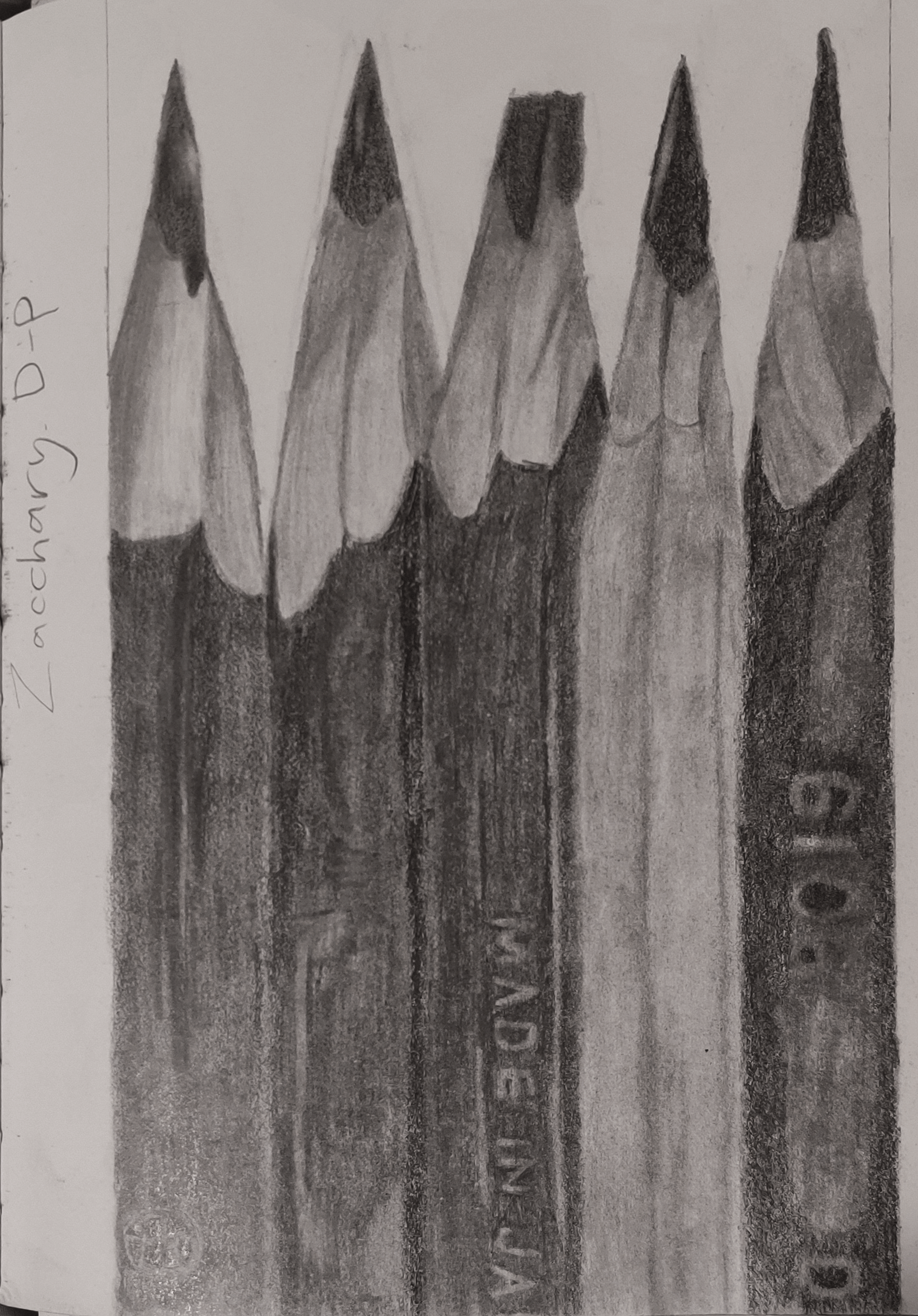 A drawing of 5 pencils side-by-side.