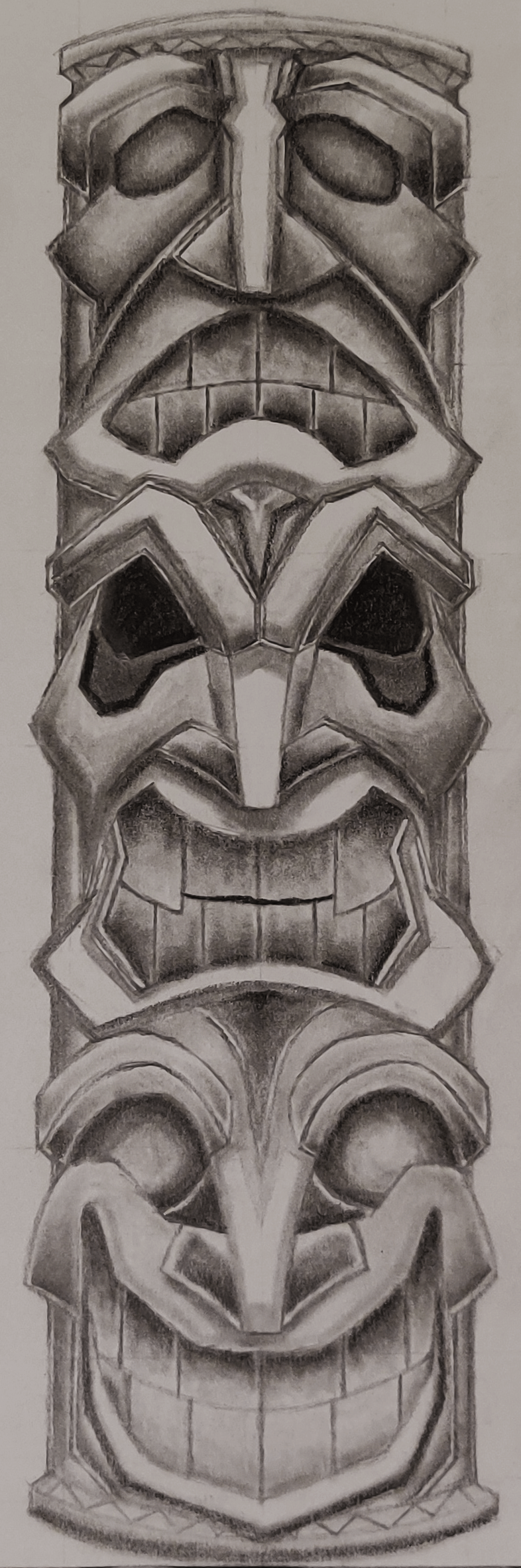 A drawing of a totem pole in pencil.